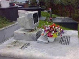 Picture of a cemetery with a computer and flowers in front of it